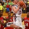 Tribune-Star/Jim Avelis<br /> Flying high: Terre Huate North guard Austin Lewis drives the lane against Evansville Harrison.