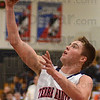 Tribune-Star/Jim Avelis<br /> Chip shot: Terre Haute North's Austin Lewis scores on a second quarter layup in the Patriot's game with visiting Evansville Harrison.