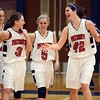 Tribune-Star/Joseph C. Garza<br /> Took down the Giants: Terre Haute North's Nicole Anderson (42) celebrates the team's win over Ben Davis Saturday with teammates Kathryn Ruark, Morgan Seeley and Morgan Stewart at North.