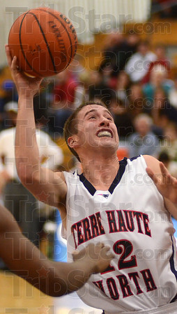 Tribune-Star/Jim Avelis<br /> Something to smile about: Terre Haute North's Nathan Jahn gets of a shot under pressure in the Patriot's matchup with Evansville Harrison.