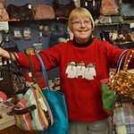 Tribune-Star/Joseph C. Garza<br /> Purses? She's got purses!: Dena Samm displays some of the purses she has for sale at her booth in Another Man's Treasure at 1437 Ohio Street.