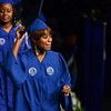 Tribune-Star/Joseph C. Garza<br /> Got it!: Indiana State University graduate Lauryn Price shows off her diploma after receiving it from President Dan Bradley Saturday during the winter commencement at Hulman Center.