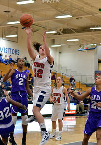Tribune-Star/Joseph C. Garza<br /> Through the Giants: Terre Haute North's Nicole Anderson drives to the basket against the Ben Davis defense during the Patriots' win Saturday at North.