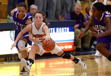 Tribune-Star/Joseph C. Garza<br /> Keep away: Terre North's Morgan Seeley keeps the ball away from Ben Davis' Brionna Arnold as teammate Jade Mills-Harris closes in during the Patriots' win Saturday at North.