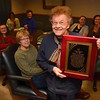 Tribune-Star/Joseph C. Garza<br /> Fifty and counting: Norma Pearson displays the plaque presented to her for her 50 years of service during a party at the Wilkinson Law Firm Thursday, Dec. 15.