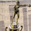 Trophy: Detail photo of John Benna's Golden Gloves Championship Trophy from 1938.