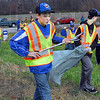 Project: Terre Haute Havoc traveling baseball team members Austin Stevenson and Nick Barrett (with bag) walk along Fagin road picking up trash Saturday as part of a community service project.