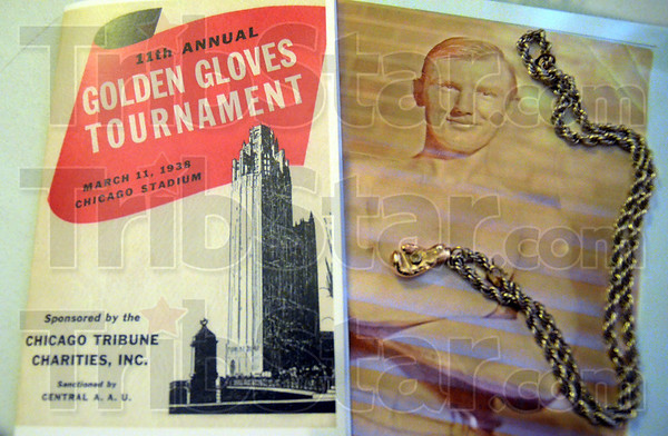 """Memories: John Benna memorabilia including a photograph, program and """"Golden Gloves"""" jewelry were on display Saturday."""