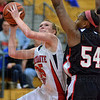 Tribune-Star/Jim Avelis<br /> Tall order: Terre Haute South center Hannah Lee faced Nariah Taylor most of the afternoon in the Braves game with North Central.