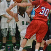 Tribune-Star/Jim Avelis<br /> Fouled: West vigo standout Jordan Houser is fouled by Owen Valley's Josh Parker in front of the Viking student section in their WIC matchup Saturday night.