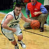 Tribune-Star/Jim Avelis<br /> Stop him: Owen Valley coach Chad Smith shouts instructions to his team as West Vigo guard Cade lindsey drives to the basket in their Saturday night game in the Green Dome