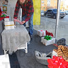 Tribune-Star/Jim Avelis<br /> Deck the halls: John Slamone places Christmas boxes in the front window of Riverwools as part of the decorating for Miracle on 7th street. The downtown displays will be judged today and the winners announced Friday.