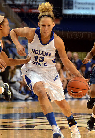 Tribune-Star/Jim Avelis<br /> Coming in: Deja Mattox drives in to score in first half action Wednesday night in Hulman Centerr.