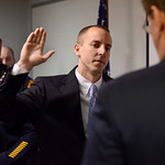 Tribune-Star/Joseph C. Garza<br /> An oath of service: New Terre Haute Police Department Officer Matthew Murray takes an oath of service from Mayor Duke Bennett as Police Chief John Plasse looks on during a swearing in ceremony Wednesday at police headquarters.