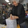 Tribune-Star/Jim Avelis<br /> Boxed in: Martha Crossen tapes white wrapping paper on one of the boxes for the front window of her Wabash Avenue store Riverwools.