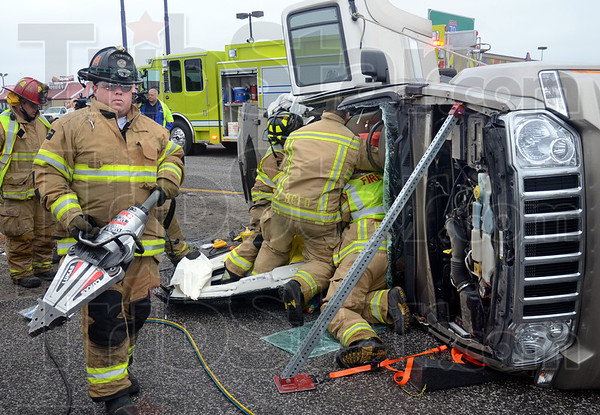 "Jaws: Honey Creek firefighters used the ""Jaws"" to remove the top of an SUV and remove the driver and passenger in a cross-over near Johnson Avenue on US 41 Wednesday afternoon."