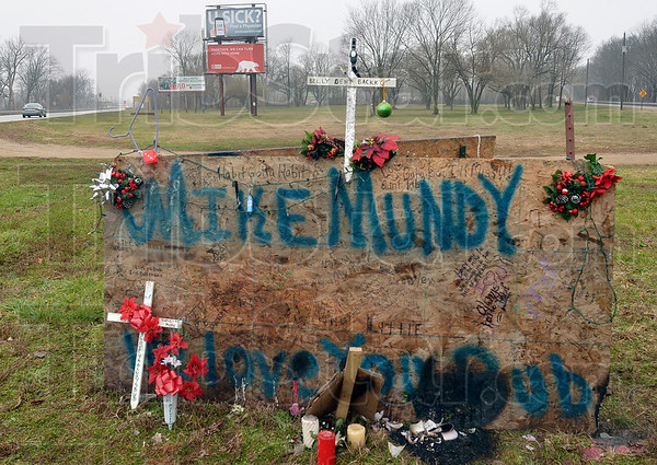Tribune-Star/Joseph C. Garza<br /> For Mike: A memorial for Mike Mundy has been erected on U.S. 40 east of West Terre Haute.