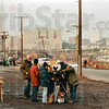 Photo by Mike Kukral<br /> On location: With the Cleveland skyline in the background, a film crew shoots a scene for the movie, A Christmas Story, in 1983.