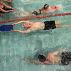 Tribune-Star/Jim Avelis<br /> Varied abilities: Steve Fleschner, center, and other Master Torpedoes workout Monday night. The group accomodates different skill levels.