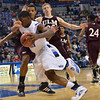 Tribune-Star/Joseph C. Garza<br /> Hard nosed about it: Indiana State's Myles Walker takes a hand to the nose as he drives to the basket against the Louisiana-Monroe defense Wednesday at Hulman Center.