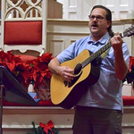 """Tribune-Star/Joseph C. Garza<br /> Shining a light in the darkness: Doug Champion sings """"O Holy Night"""" as part of the Longest Night service Wednesday at First Congregational Church."""