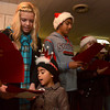 Tribune-Star/Joseph C. Garza<br /> Frosty the Snowman just for you: Amanda Mansard and her cousin, Zoe Valdez, 5, sing Christmas carols for Janis Neal which was part of  Youth Embracing Service's effort to bring the songs to terminally ill people Wednesday evening.