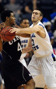 Tribune-Star/Joseph C. Garza<br /> Swiped: Indiana State's Jake Odum steals the ball away from Louisiana-Monroe's R.J. McCray during the Sycamores' 50-35 win Wednesday at Hulman Center.