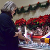 Tribune-Star/Joseph C. Garza<br /> Lighting a candle of love: Rev. Dawn Carlson of First Congregational Church lights a candle as part of the Longest Night service Wednesday at the church.