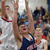 Behind: North's #40, Ross Sponsler has his shot blocked from behind by an Owen Valley player during Wednesday's game.