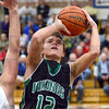 Score: West Vigo's #12, Jordan Houser shoots and scores while driving the lane against a Shakamak defender Wednesday night during Pizza Hut action.