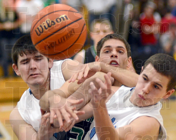 Ball battle: West Vigo's #34,Nathan Gregg is sandwiched between Shakamak players #50, Justin Crody and #44, Christian Burris as they battle for a rebound Wednesday night.