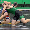 Takedown: West Vigo's Ben Bird (green) takes down North's Zach Schmidt during match action at the Green Dome Wednesday night. Bird eventually pinned Schmidt for the win.