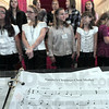 Medley: Members of the Terre Haute Children's Choir wait for the start of rehearsal Wednesday afternoon.
