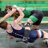 Going down: West Vigo's Sam McClain (green) manhandles North's Daniel Miller during match action at the Green Dome Wednesday evening. McClain was the winner of the 182 lb. division.