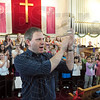 Choir clap: Terre Haute Children's Choir director Daniel Tryon leads his choir during Wednesday's rehearsal.