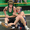 113: West Vigo's Zac Otte (L) and North's Kyle Camp grapple during their match Wednesday evening in the Green Dome.