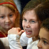 Fun: Five-year-old Morgan Tryon (center) enjoys a break in the singing action Wednesday evening during the Children's Choir rehearsal.