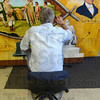Tribune-Star/Jim Avelis<br /> About done: Bill Wolfe finishes his mural depicting scenes from the life of Francis Vigo. His mural will be on display, eventually with three otheres, in the Vigo County courthouse.