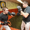 Tribune-Star/Jim Avelis<br /> Sparring: Zach Edington works out at the McVickers Martial Arts studio Monday evening. His sparring partner is Keith Smetana, himself a professional MMA fighter and instructor.