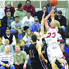 Pizza delivery: Marshall's Lucas Eitel drives to the basket against the Northview defense as spectators look on during the second game of the Pizza Hut Wabash Valley Classic Wednesday at Terre Haute North.