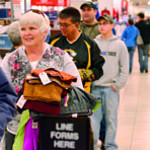 Tribune-Star/Joseph C. Garza<br /> Day after sale bargains: Jona Uptmor of Robinson waits patiently in line to make her purchase at J.C. Penney's Monday at the Honey Creek Mall.
