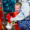 Tribune-Star/Joseph C. Garza<br /> It's 70% off!: Five-year-old Jaceston Edmondson's attention is captured by an ornament as he shops Monday with his cousin, Courtney Burris, and grandmother, Tracy Stevenson, at the Honey Creek Mall.