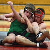 Tribune-Star/Jim Avelis<br /> Technical tangle: West Vigo's Harold Coopers it tied up by Terre Haute South's Ian Newton. Newton won the match on a technical fall.