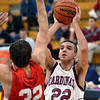 Blocked: Bloomfield's #22, Ben Hays attempts a shot over Marshall's #32, Taylor Maurer during the first game of the annual Pizza Hut Classic Tuesday morning. Maurer managed to get a blocked shot on the play.