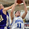 Rebound: Rockville's #11, Joel Wittemyer rips down a rebound against Sullivan's #31, Caleb Turner during Pizza Hut Classic action.