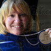 Tribune-Star/Jim Avelis<br /> Sealed: Dottie King holds her Presidential medallion after her inaugration as St. Mary-of-the-Woods' 16th president this past October.
