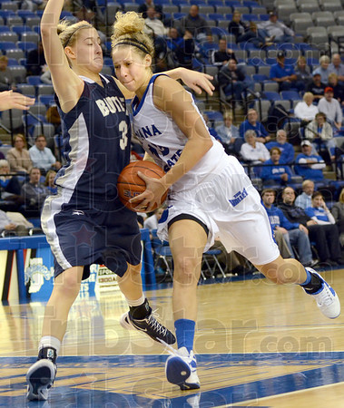 Hard to the hoop: Indiana State's #13, Deja Mattox drives the ball hard down the lane late in the game against a Butler defender. Mattox finished with 12 points and 10 rebounds.