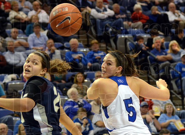 Eye on the prize: Butler's Becca Bornhorst and Indiana State's Shannon Thomas watch the ball fly past during game action Tuesday.