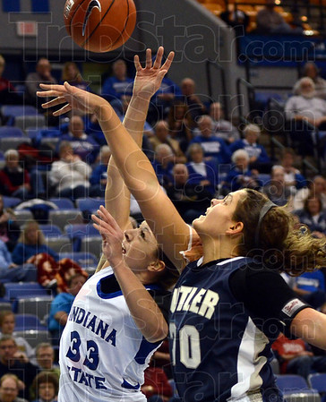 Challenged: Indiana State's #33, Anna Munn is challenged by Butler's #20, Becca Bornhorst during game action at Hulman Center Tuesday evening.