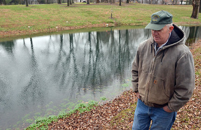 Tribune-Star/Joseph C. Garza<br /> Safety measures: Keith Ruble, superintendent of Vigo County Parks and Recreation, talks Tuesday about the new markers put in place to help department employees when they mow near the pond at Prairie Creek Park.